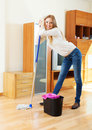 Long haired housewife with mop happy washing floor Stock Photography