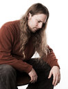 Long haired man is sad Royalty Free Stock Images