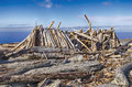 Long house beach shelter a rough made out of driftwood and logs resembles a on the shores of puget sound in washington state Stock Photography