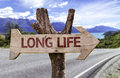 Long Life wooden sign with a street background Royalty Free Stock Photo