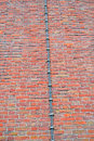 Long metal wire (lightning-conductor) on red brick wall, Stock Images