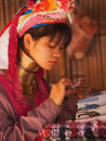 Long neck woman in thailand chian mai march street portrait of a young there are copper rings on her weighting kilograms she has Royalty Free Stock Photos