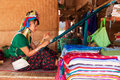 Long neck woman weaving chian mai thailand march street portrait of a young in a factory made of bamboo there are copper rings on Royalty Free Stock Images