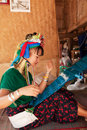 Long neck woman weaving chian mai thailand march street portrait of a young in a factory made of bamboo there are copper rings on Stock Image