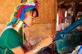 Long neck woman weaving chiang mai thailand march street portrait of a young in a factory made of bamboo there are copper rings on Stock Image