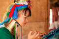 Long neck woman weaving chiang mai thailand march street portrait of a young in a factory made of bamboo there are copper rings on Royalty Free Stock Image