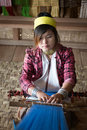 Long-necked Kayan Lahwi woman weave on traditional device Royalty Free Stock Photo