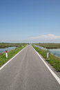 Long paved road islands in the lagoon Stock Photography