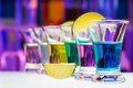 Long perspective row of shots with color drinks Royalty Free Stock Photo