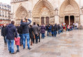 Long queue crowd of people to notre dame de paris france january waiting in line queueing in front entrance Royalty Free Stock Image