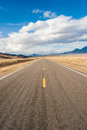 Long road in a desert storm through winter Stock Image