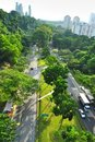 A long road with lush greenery, seen from a height Royalty Free Stock Photography