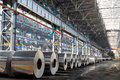 Long row of rolls of aluminum in production shop plant Stock Images