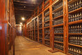 Long rows of shelves made of mahogany funchal madeira october the are with sweet wine bottles madera museum Stock Photos