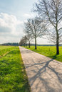 Long seemingly endless straight road in a flat landscape Royalty Free Stock Photo