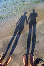 Long shadow of couple holding hands Royalty Free Stock Photo