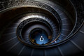 Long spiral, winding stairs. Dark shadows, soft light. Royalty Free Stock Photo