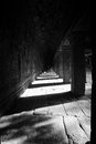 Long stone corridor in cambodian temple ruins Royalty Free Stock Photography