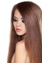 Long Straight Hair. Beautiful Brunette Girl with Healthy and Shi Royalty Free Stock Photo