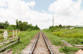 Long straight piece of rail track with blue sky Royalty Free Stock Photos