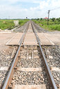 Long straight railroad on concrete sleepers in a rural Stock Photo