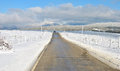 Long straight road middle rural area winter Stock Images