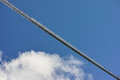 Long suspension footbridge in blue sky with cloud Royalty Free Stock Photo