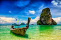Long tail boat on beach thailand tropical pranang and rock krabi Royalty Free Stock Image