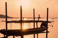 Long tail boat at beautiful sunset orange sky reflect with water lake at traditional folk fishing village in south Thailand Royalty Free Stock Photo