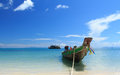 Long Tail Boat in Clear Water and Blue sky Stock Photo