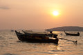 Long tail boat krabi thailand under sun set Stock Photos