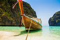 A long tail boat in maya bay sits the beautiful ko phi phi ley thailand Stock Image