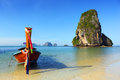 Long tail boat on tropical beach in thailand pranang and rock krabi Royalty Free Stock Image
