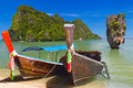 Long tail boats on the coast of andaman sea in thailand Stock Photos