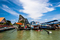 Long tail boats limestone karsts and at koh panyee floating fishing village phang nga bay southern thailand Royalty Free Stock Images