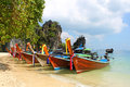 Long tail boats on tropical beach with limestone rock holiday vacation concept background krabi thailand Royalty Free Stock Photography