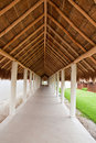 Long Walkway Under Straw Thatched Roof Stock Photography
