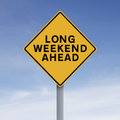Long weekend ahead conceptual road sign indicating Royalty Free Stock Photography