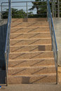 Long wide flight of outdoor steps with stainless steel handrails Royalty Free Stock Photo