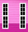 Long window white wood in the pink wall.