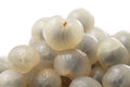 Longan close up of peeled isolated over white background Stock Images