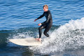 Longboard surfer tyler newell surfing in santa cruz california the surf breaks of are designated as a world reserve Royalty Free Stock Image