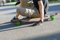 Longboarder Sitting
