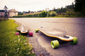 Longboarding longboard by the asphalt road at the border of a village toned image Royalty Free Stock Photo
