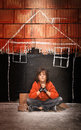 Longing for the security of a home homeless child and praying Royalty Free Stock Image