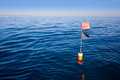 Longliner and trammel net buoy with flag pole Royalty Free Stock Photography