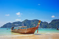 Longtail boat in the beautiful sea over clear sky at phi phi island Stock Photo