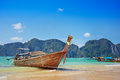 Longtail boat in the beautiful sea over clear sky tropical island Stock Photography
