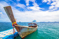 Longtail boat and blue dock Royalty Free Stock Photo