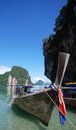 Longtail boat in thailand traditional with rock formations and blue sky background Royalty Free Stock Images